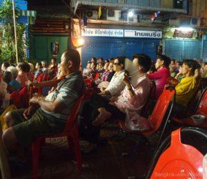 Publikum bei chinesischer Oper